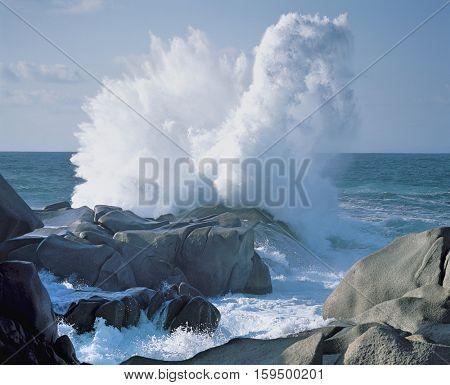 Ocean Waves Breaking on a Rocky Shore
