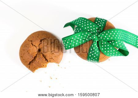Cookies Tied With Green Ribbon And Bitten Cookie With Crumbs, On White Background.