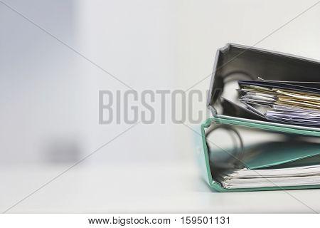 Two file folders on office desk