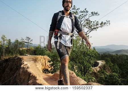Guy Exploring Freedom Outdoors Concept