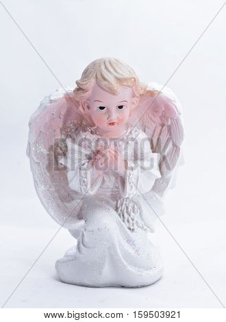 One little Christmas angel on a white background