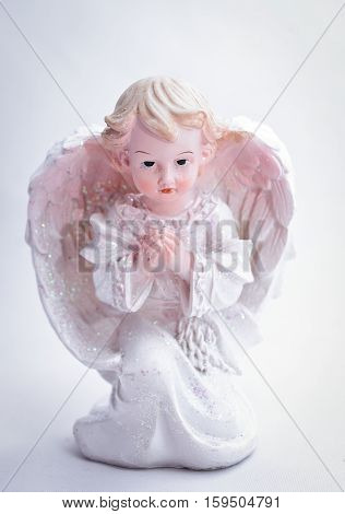 little Christmas angel on a white background