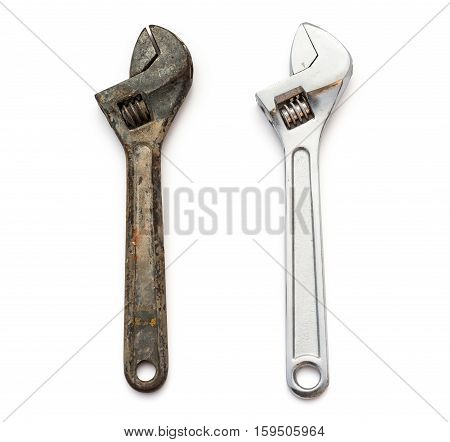 a rusty and a good wrenches on white background
