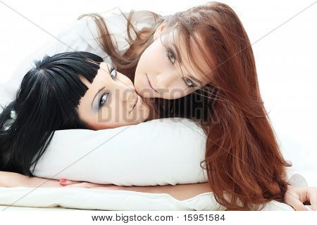 Two women lesbians in a bed.