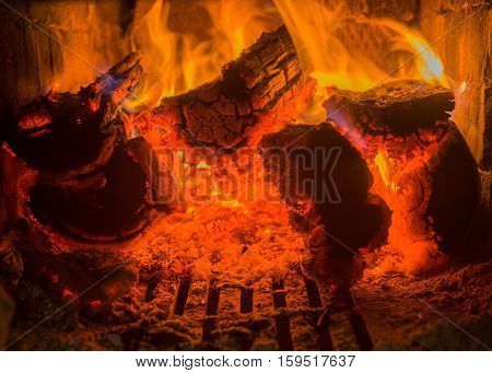 Brightly and hot burning firewoods inside furnace