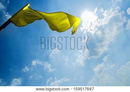 flag on a background of the dark blue sky with clouds