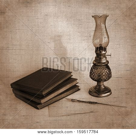 Blank paper card oil lamp and inkwell with a dip pen as a concept of greetings on holidays. Photos with the effect of natural canvas in sepia tone.