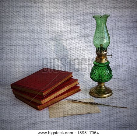 Blank paper card oil lamp and inkwell with a dip pen as a concept of writing letters and greetings on holidays. Photos with the effect of natural canvas.