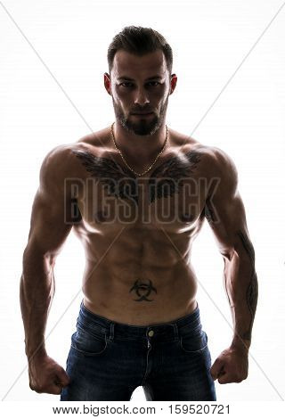 Handsome shirtless muscular man with jeans, standing, isolated on white background