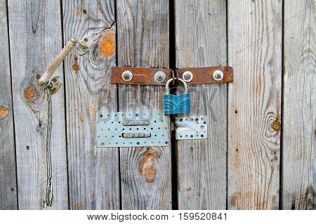 Wooden grey door with handle lock and combination lock