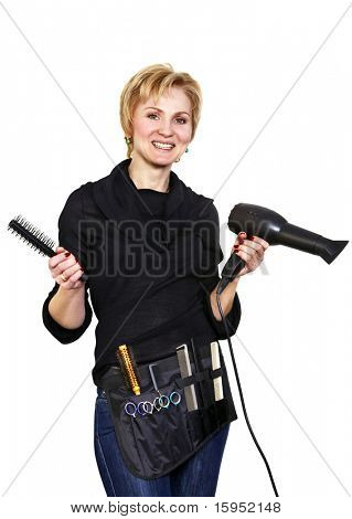Portrait of smiling hairdresser with her work tools