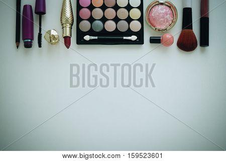Set of decorative cosmetics, eye shadow, brush, blush, lip gloss, lipstick, eye brow pencil and mascara