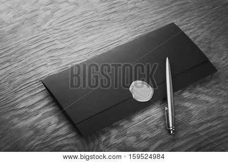 envelope with stamp and pen on the wooden table