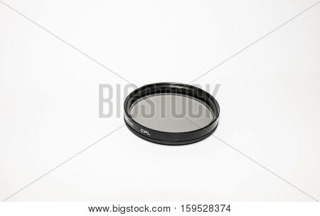 Black polarizing filter for a camera lens on a bright white background