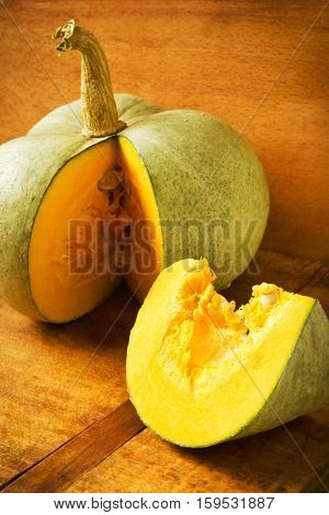 Fresh sweet pumpkin on a wooden background