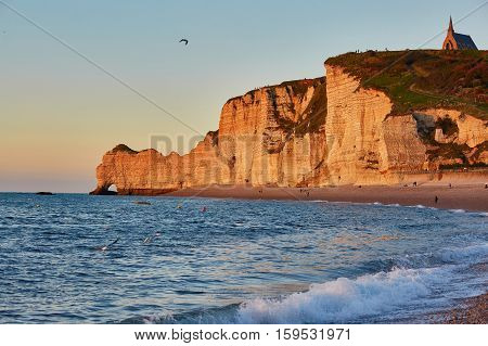 Scenic View Of Etretat With Its Beach And Famous Cliffs