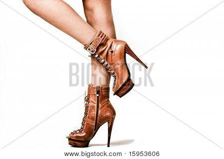 female legs in brown high heel platform shoes, studio shot