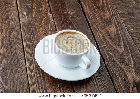 Coffee Cup With Foam On Dark Wood Background
