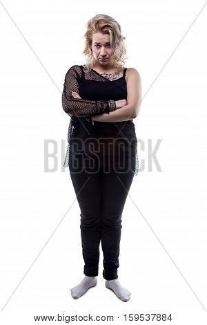 Frowned young blond woman on white background