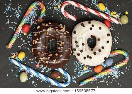 Glazed Donuts On Black Background