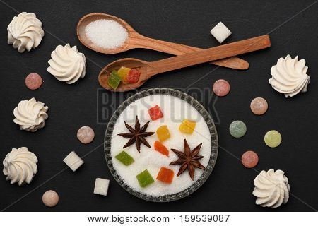 Sweets On Black Textured Background