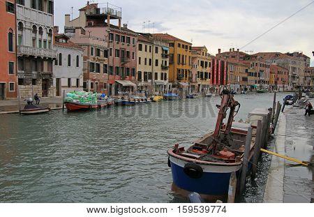 Venice, Italy - November 23, 2015: people are walking nearly Cannaregio Canal in Venice, Italy