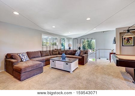 Cozy Game Room With Brown Sectional Sofa