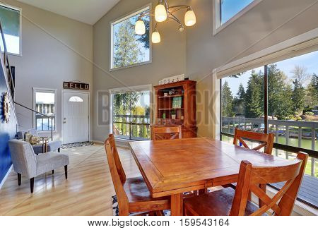 Open Concept Dining Room With Rustic Table Set.