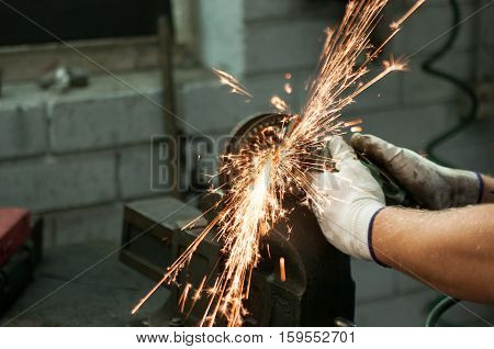 Car mechanic at work. Dangerous job. Hands.