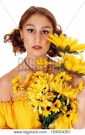 Gorgeous young woman in a yellow blouse holding a bunch of sunflowers standing closeup isolated for white background.
