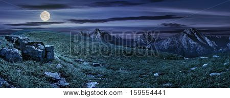 Huge Stones In Valley On Top Of Mountain Range At Night
