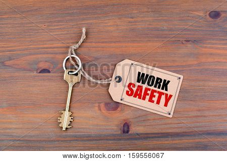 Key and a note with text - Work Safety.