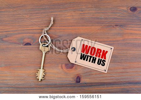 Key and a note with text - Work with us.