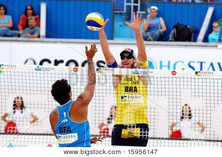 PRAGUE - JUNE 18: Alison Cheruti (BRA) in yellow on the block at SWATCH FIVB World Tour 2010 June 18, 2010 Prague
