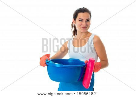 happy young maid woman in uniform with cleansers isolated on white background