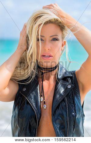 A blonde model enjoying the beach