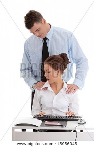 harassment at work concept. Man harassing a woman