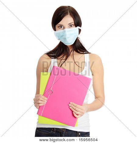 Caucasian student woman with mask on her face. She is defending her self from viruses. Isolated on white
