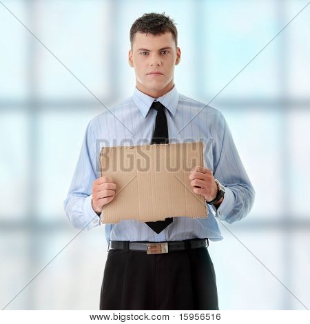 Unemployed businessman with blank cardboard sign