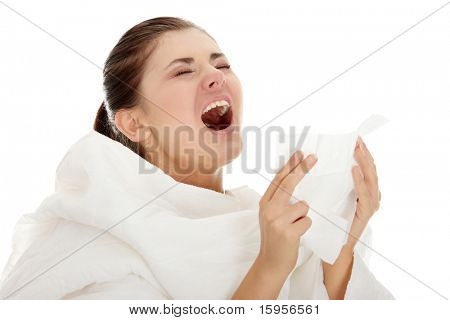 Young beautiful sick woman sneezing ,isolated on white background