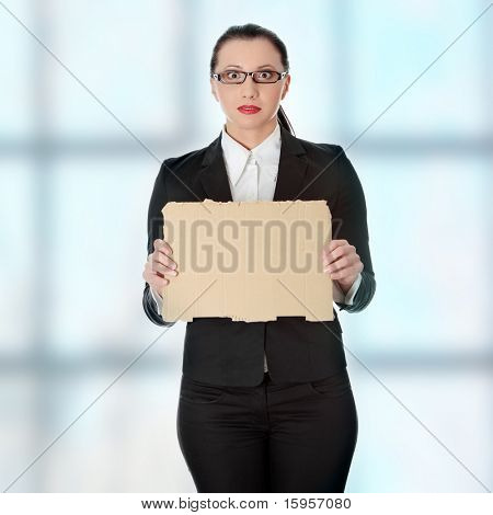 Unemployed businesswoman with empty cardboard sign