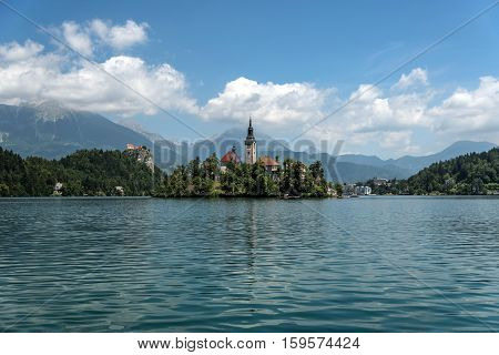 Beautiful view of the Lake Bled with the Bled castle, the pilgrimage church of the Assumption of Maria on the Bled island and the Julian alps in background, upper Carniola region, Slovenia