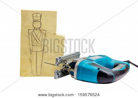 Piece of wood with a pencil drawing of a soldier and jigsaw. Soldiers will be sawed jigsaw.
