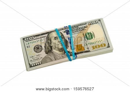 Stash of hundred dollar banknotes with rubber band isolated