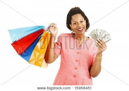 Beautiful african-american woman with cash to spend on a shopping spree.  Isolated on white