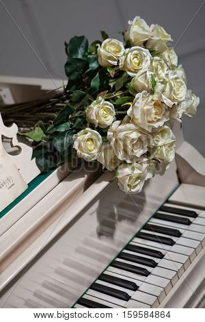 Bouquet of roses on the grand piano