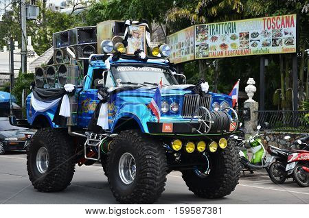 PATTAYA THAILAND - 19 NOV 2016: Giant truck carry photo of recently deceased Thailand king in Beach Road Pattaya in the event of memorial ceremony to honour His Majesty the King.