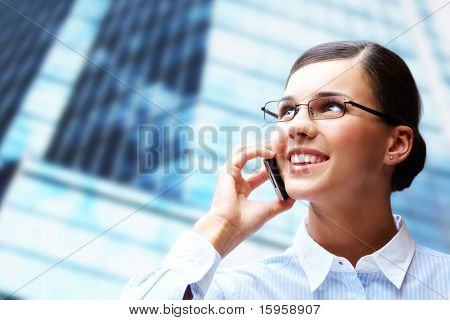 Photo of smart businesswoman calling somebody by mobile telephone