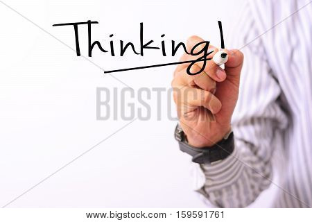 business concept image of a hand holding marker and write thinking isolated on white