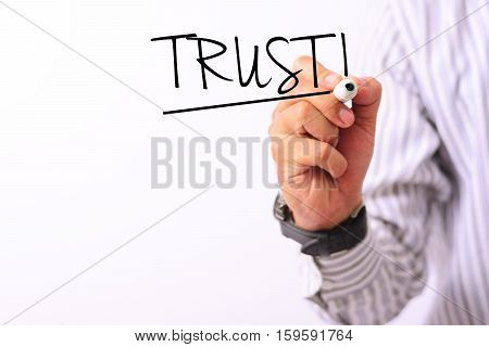 business concept image of a hand holding marker and write trust isolated on white
